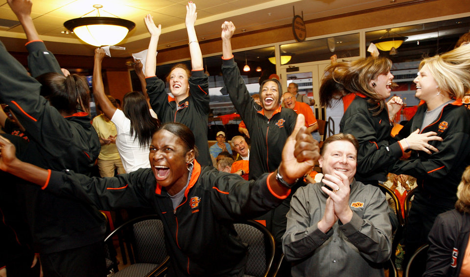 Photo - Rashidat Sadiq, left, and head coach Kurt Budke celebrate after hearing the Cowgirls announced as a 10-seed in the NCAA tournament during a watch party for the Oklahoma State University Cowgirls, at Boone Pickens Stadium in Stillwater, Okla., Monday, March 12, 2007. By Matt Strasen, The Oklahoman