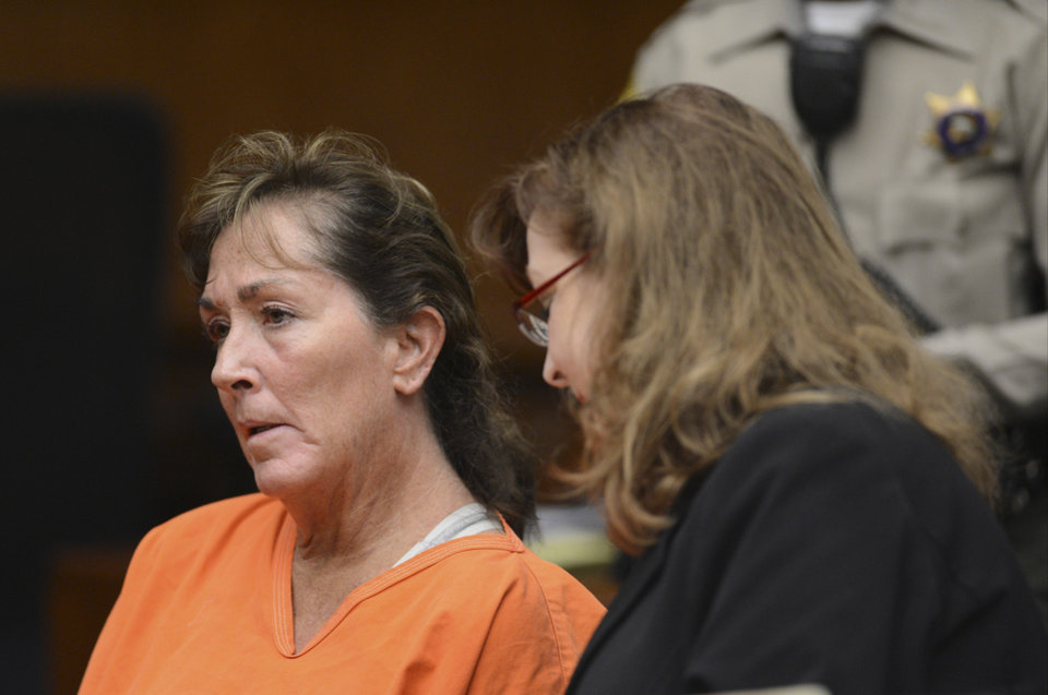 Photo -   Sherri Wilkins, a substance abuse counselor, left, is arraigned at Torrance Superior court in Torrance, Calif., Tuesday, Nov. 27, 2012. Fifty-one-year-old Wilkins, who was while driving under the influence allegedly struck a pedestrian and drove for more than two miles with the dying victim on the hood of her car. Los Angeles County prosecutors have filed murder and drunken-driving charges against Wilkins. Wilkins struck victim, 31-year-old Phillip Moreno, who died later at a hospital. At right, public defender Ethna Burns. (AP Photo/Daily Breeze,Brad Graverson, Pool)