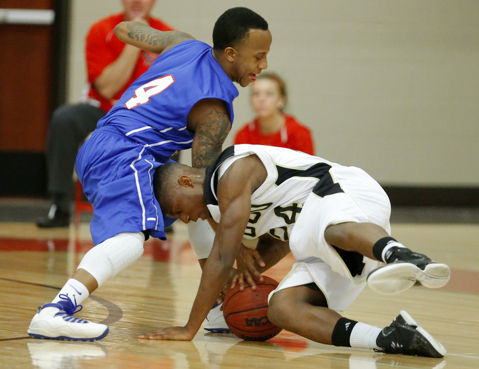 Hugo's Trey Johnson, at right, tries to gain control of the ball beside Millwood's Jaylen Edwards during a Class 3A boys state basketball tournament game between Hugo and Millwood at Yukon High School in Yukon, Okla., Thursday, March 7, 2013. Photo by Bryan Terry, The Oklahoman
