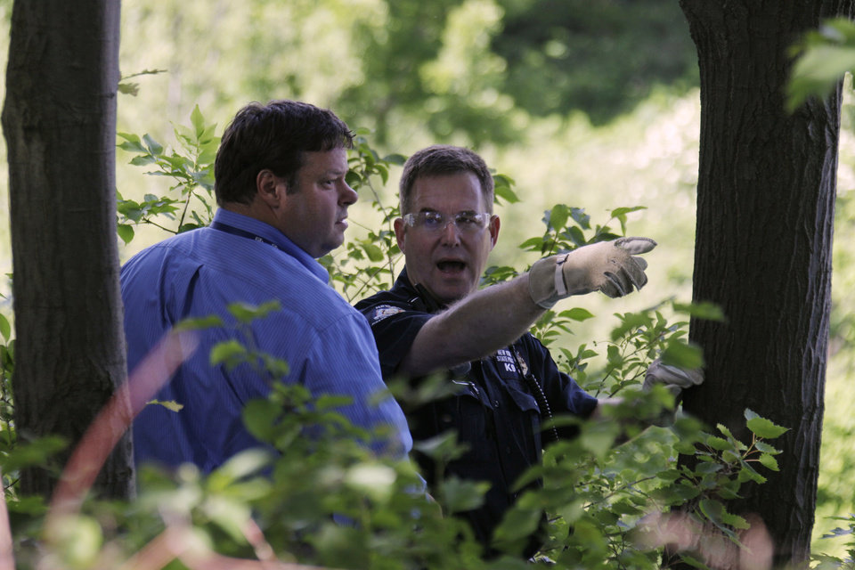 Photo -   Law enforcement officers search near the home of Dr. Timothy Jorden in Hamburg, N.Y., Thursday, June 14, 2012. Jorden is sought in connection with the hospital shooting death of his ex-girlfriend at Erie County Medical Center in Buffalo, N.Y. on Wednesday. (AP Photo/David Duprey)
