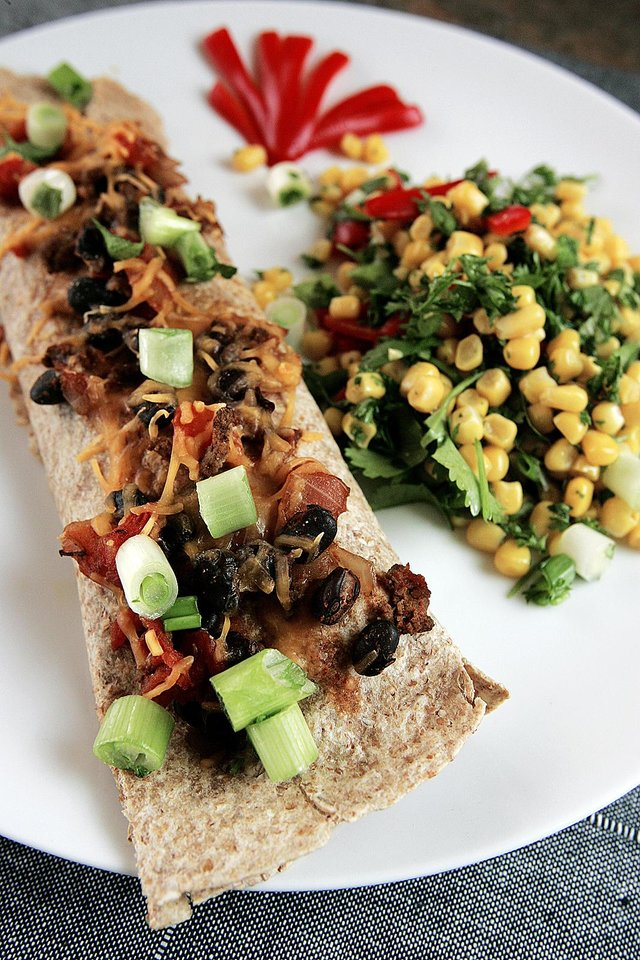 Photo - A perfect lunch per MyPyramid standards is a beef and black bean burrito and Southwest corn salad with cilantro and red pepper.  Photo by Jaconna Aguirre, THE OKLAHOMAN