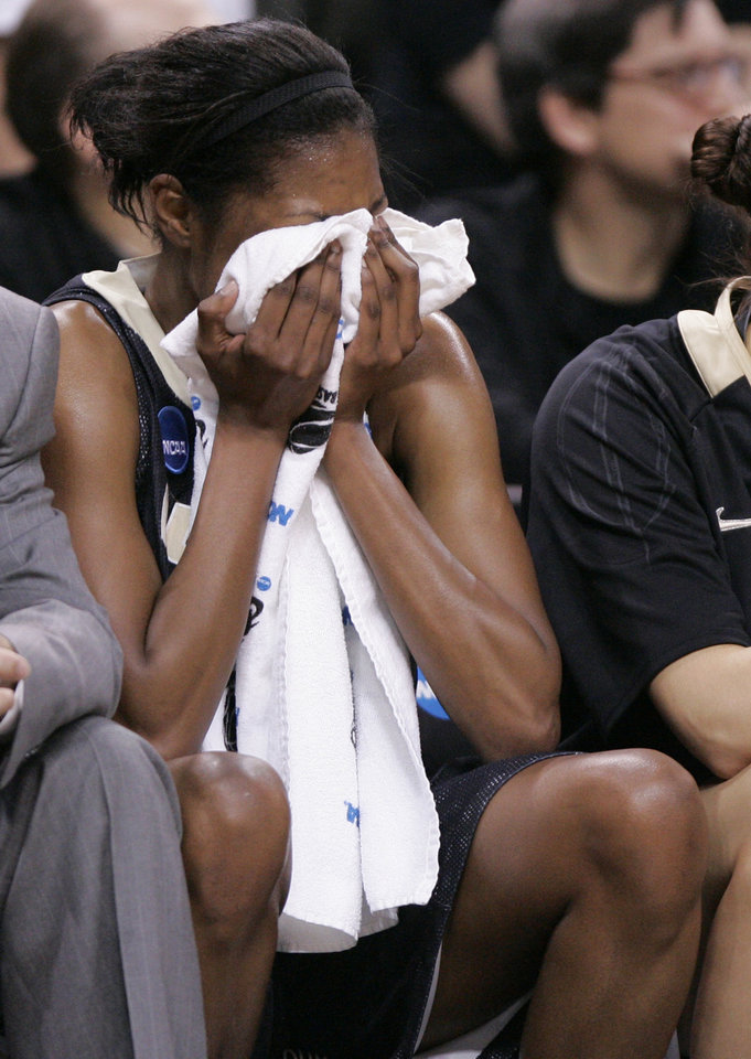 Photo - Purdue's Danielle Campbell covers her face near the end of the OU's win during the NCAA women's basketball regional  tournament finals between Oklahoma and Purdue at the Ford Center in Oklahoma City, Tuesday, March 31, 2009.  OU won74-68. Photo by Bryan Terry, The Oklahoman