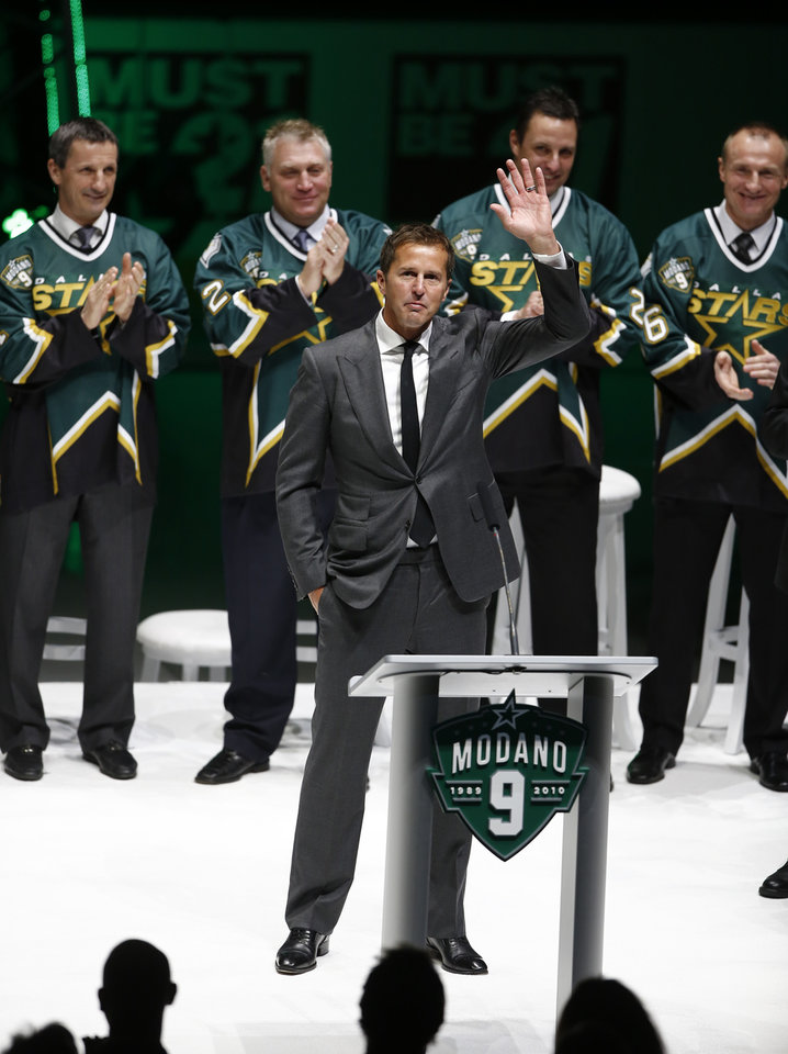 Photo - Former Dallas Star Mike Modano waves to the crowd during his jersey retirement ceremony before the NHL hockey game between the Stars and the Minnesota Wild on Saturday, March 8, 2014, in Dallas. (AP Photo/The Dallas Morning News, Nathan Hunsinger) MANDATORY CREDIT; MAGS OUT; TV OUT; INTERNET USE BY AP MEMBERS ONLY; NO SALES