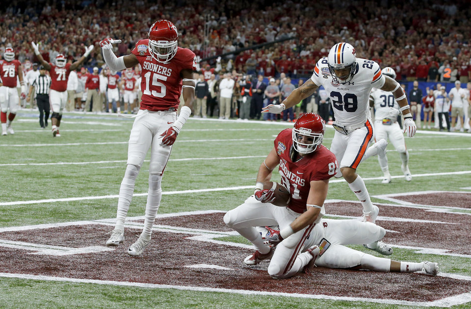 Photo - Oklahoma's Mark Andrews (81) catches a pass for a touchdown as Jeffery Mead (15) celebrates during the Allstate Sugar Bowl between the University of Oklahoma Sooners (OU) and the Auburn University Tigers at the Mercedes-Benz Superdome in New Orleans, Monday, Jan. 2, 2017.  Photo by Bryan Terry, The Oklahoman