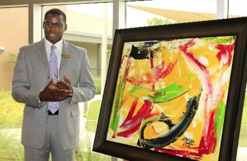 Desmond Mason, former NBA player, talks about his painting just unveiled and donated to Educare in Okla. City Thursday, July 14, 2011. Photo by Paul B. Southerland, The Oklahoman Archives