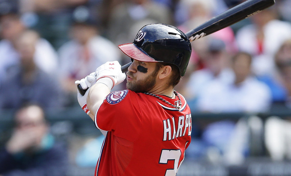 Photo - Washington Nationals' Bryce Harper hits a solo home run in the fourth inning of a baseball game against the Seattle Mariners, Sunday, Aug. 31, 2014, in Seattle. Harper also hit a solo home run in the second inning. (AP Photo/Ted S. Warren)