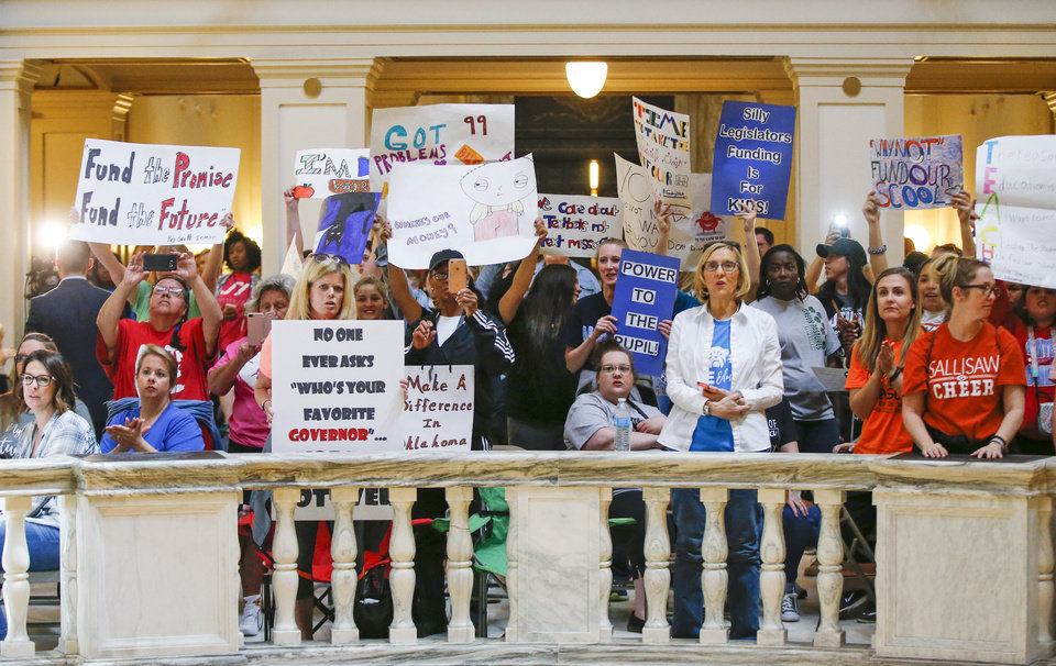 Photo - Teachers and supporters of increased education funding rally on the fourth floor of the Oklahoma state Capitol during a continuing walkout by Oklahoma teachers in Oklahoma City, Monday, April 9, 2018. (Nate Billings/The Oklahoman via AP)