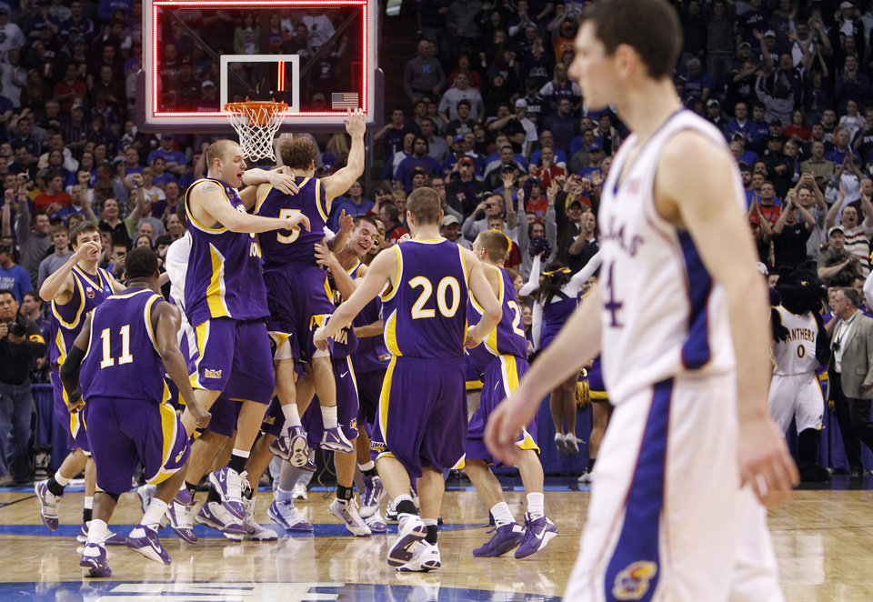 UNI celebrates the 69-67 upset win over Kansas as Jayhawk Tyrel Reed walks off the court during the NCAA Men\'s second round basketball tournament game between the University of Kansas and the University of Northern Iowa at the Ford Center on Saturday, March 20, 2010, in Oklahoma City, Okla. Photo by Chris Landsberger, The Oklahoman