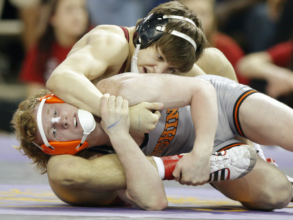 Photo - Tuttle's Brik Flippo, top, wrestles Levi Murray of Cushing in a semifinal 132 pound match in the Class 4A state wrestling tournament at Jim Norick Arena at State Fair Park in Oklahoma City, Friday, Feb., 28, 2014. Photo by Bryan Terry, The Oklahoman