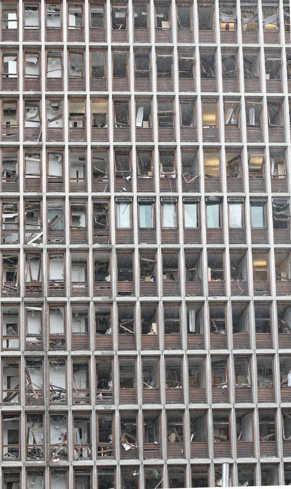 Damaged windows in a building in central Oslo, Friday July 22, 2011, following an explosion that tore open several buildings including the prime minister's office, shattering windows and covering the street with documents.(AP Photo/Berit Roald, Scanpix, Norway)