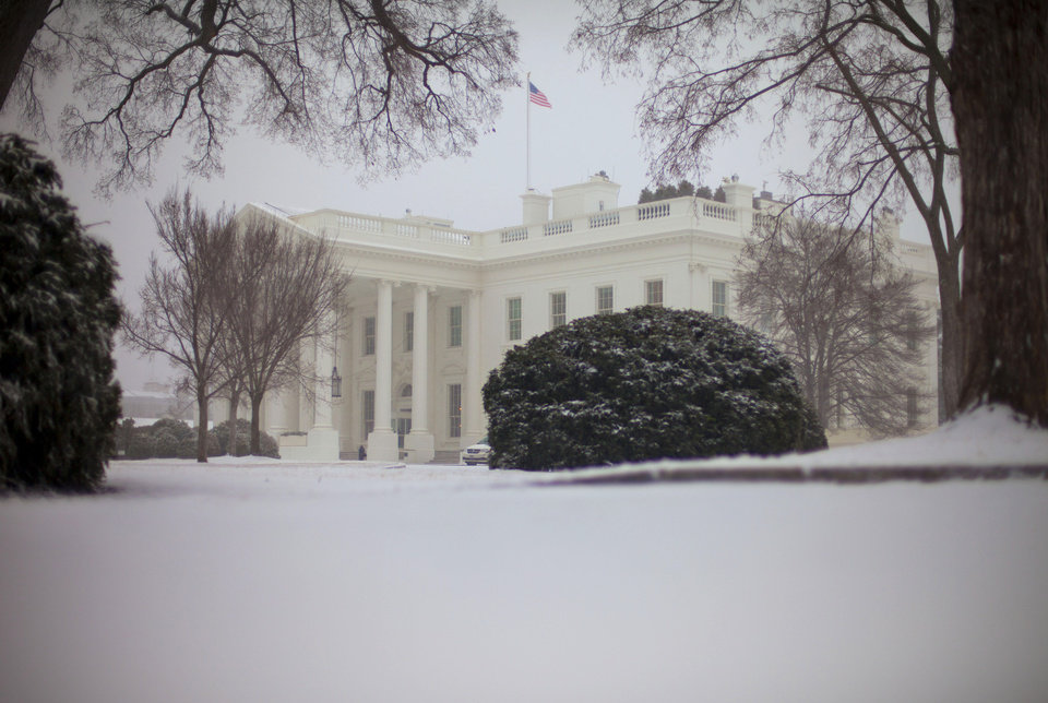 Photo - Snow falls at the White House in Washington, Monday, March. 3, 2014, prompting area schools and the federal government to close for the wintry weather. The National Weather Service has issued a Winter Storm Warning for the greater Washington Metropolitan region. (AP Photo/Pablo Martinez Monsivais)