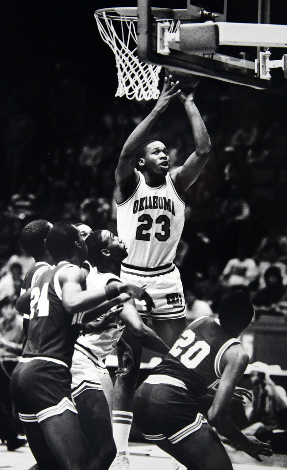 Former OU basketball player Wayman Tisdale. On offense, Tisdale rose far above the crowd. Staff photo by Doug Hoke. Photo taken 1/12/1985, photo published 3/31/1985 in The Daily Oklahoman. ORG XMIT: KOD