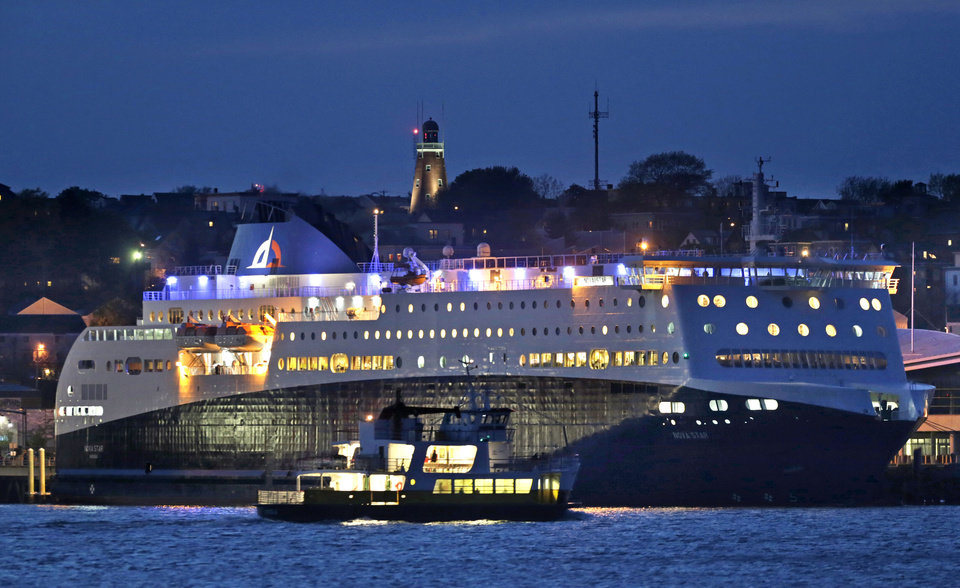 Photo - A Casco Bay Lines ferry passes by the Nova Star ferry as the 528-foot, $165 million ship prepares to make its maiden voyage from Portland, Maine to Yarmouth, Nova Scotia, Canada, Thursday, May 15, 2014. (AP Photo/Robert F. Bukaty)