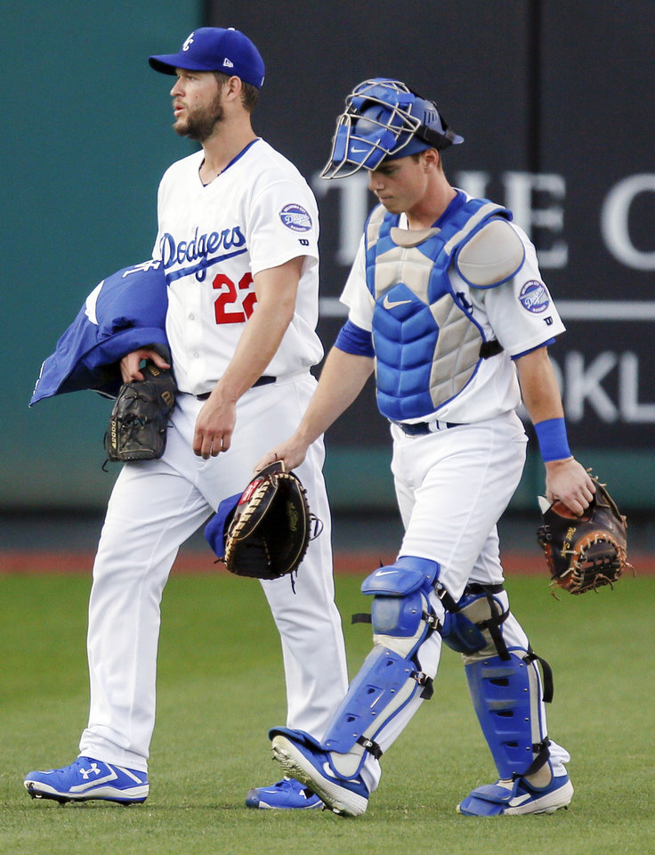 Photo -  Clayton Kershaw, left, and Oklahoma City catcher Will Smith walk to the dugout before Thursday night's game against the San Antonio Missions. Kershaw is Los Angeles' ace pitcher, while Smith is one of the Dodgers' top prospects. [Nate Billings/The Oklahoman]