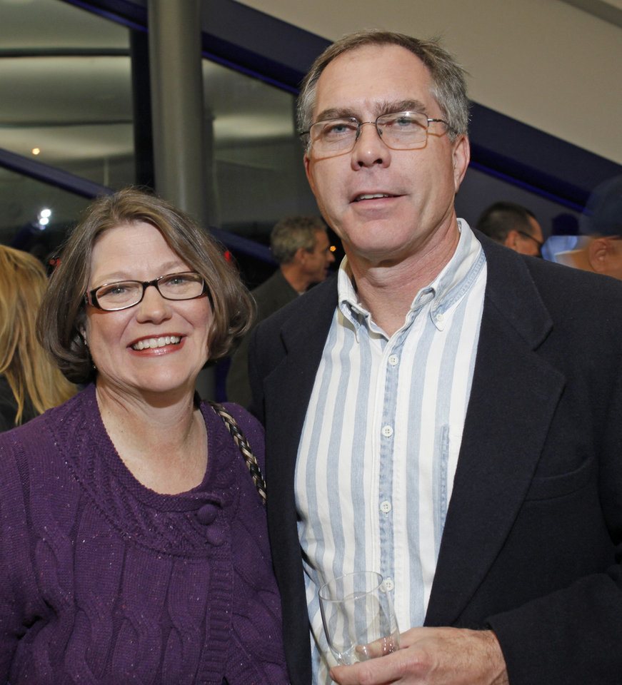 From left: Sandra and Kevin Farmer during A Perfect Finish Wine and Food Tasting fundraiser for the junior rowing program at the Devon Boathouse at the Oklahoma River Friday, November 11, 2011. Photo by Doug Hoke, The Oklahoman