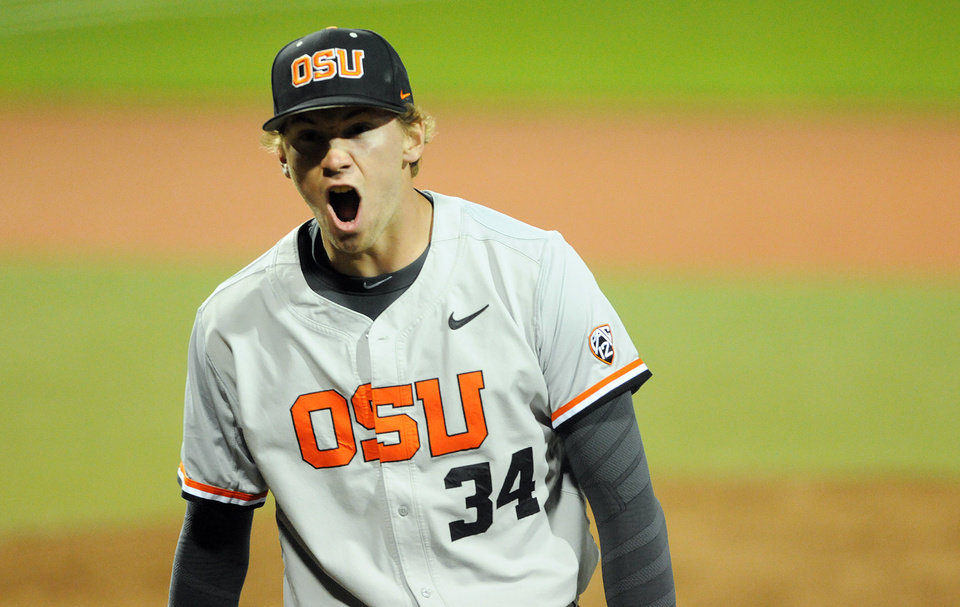 Photo - Oregon State pitcher Max Engelbrekt screams during a game against UC Irvine in an NCAA college baseball regional tournament in Corvallis, Ore., Monday, June 2, 2014. (AP Photo/Mark Ylen)