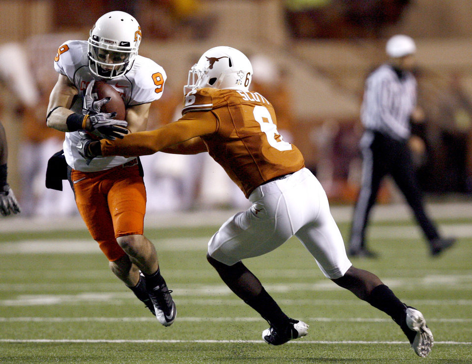 Photo - Oklahoma State's Bo Bowling (9) makes a catch as Texas' Christian Scott (6) defends during the college football game between the Oklahoma State University Cowboys (OSU) and the University of Texas Longhorns (UT) at Darrell K Royal-Texas Memorial Stadium in Austin, Texas, Saturday, November 13, 2010. Photo by Sarah Phipps, The Oklahoman