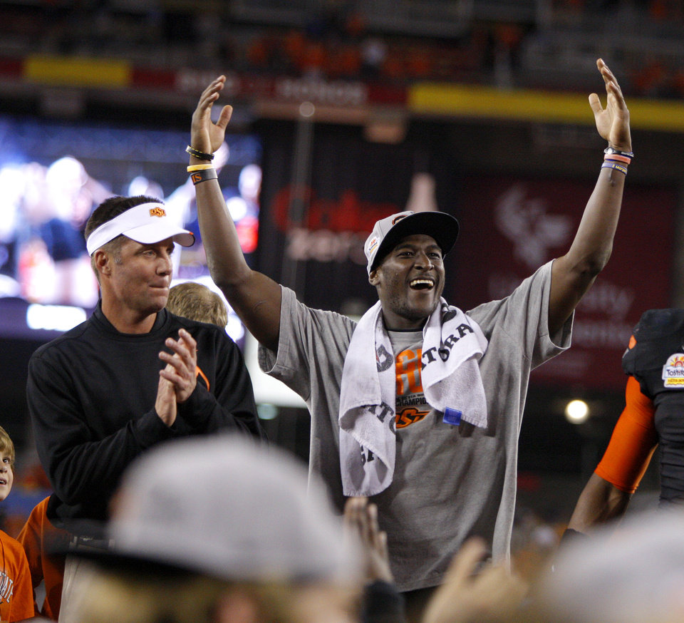 Photo - Oklahoma State's Justin Blackmon and coach Mike Gundy celebrate after winning the Fiesta Bowl between the Oklahoma State University Cowboys (OSU) and the Stanford Cardinal at the University of Phoenix Stadium in Glendale, Ariz., Tuesday, Jan. 3, 2012. Photo by Bryan Terry, The Oklahoman