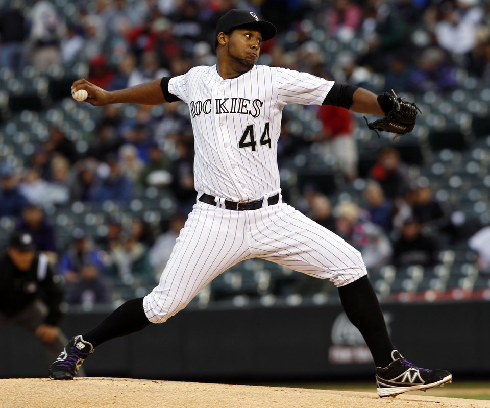 Photo - Colorado Rockies starting pitcher Juan Nicasio delivers against the New York Yankees in the first inning of a baseball game in Denver on Wednesday, May 8, 2013. (AP Photo/David Zalubowski)