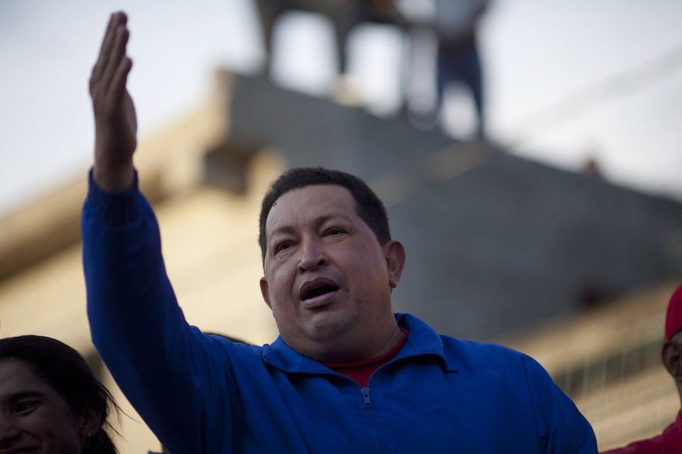 Photo -   Venezuela's President Hugo Chavez waves to supporters during a campaign rally in Barquisimeto, Venezuela, Tuesday, Oct. 2, 2012. Chavez will run for re-election against opposition candidate Henrique Capriles on Oct. 7. (AP Photo/Rodrigo Abd)