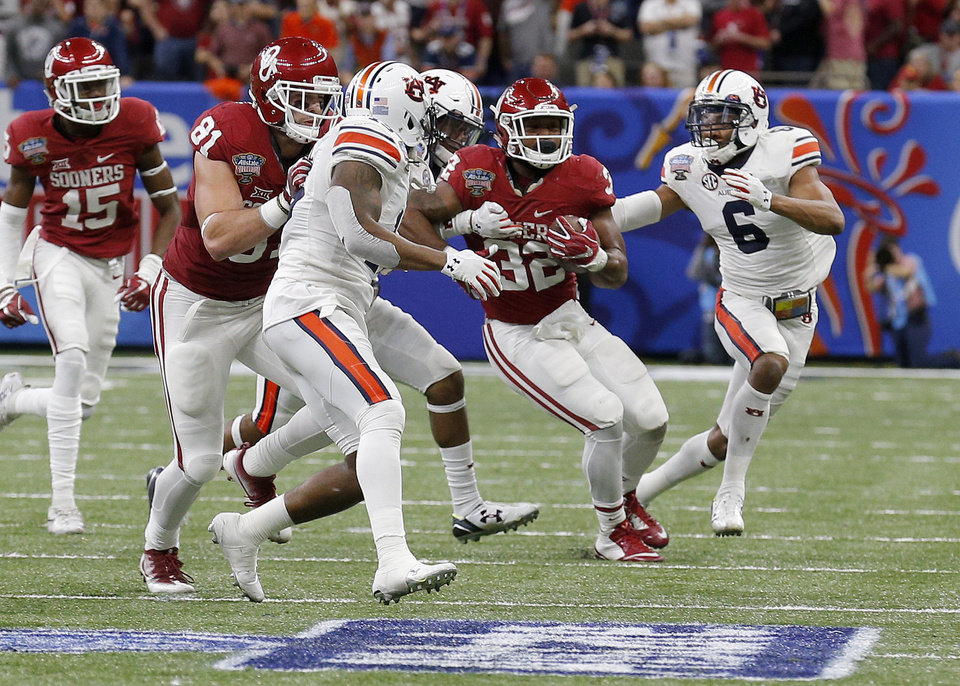 Photo - Oklahoma's Samaje Perine (32) is tackled during his record breaking rush during the Allstate Sugar Bowl between University of Oklahoma Sooners (OU) and Auburn University Tigers at the Mercedes-Benz Superdome in New Orleans, Monday, Jan. 2, 2017.  Photo by Sarah Phipps, The Oklahoman