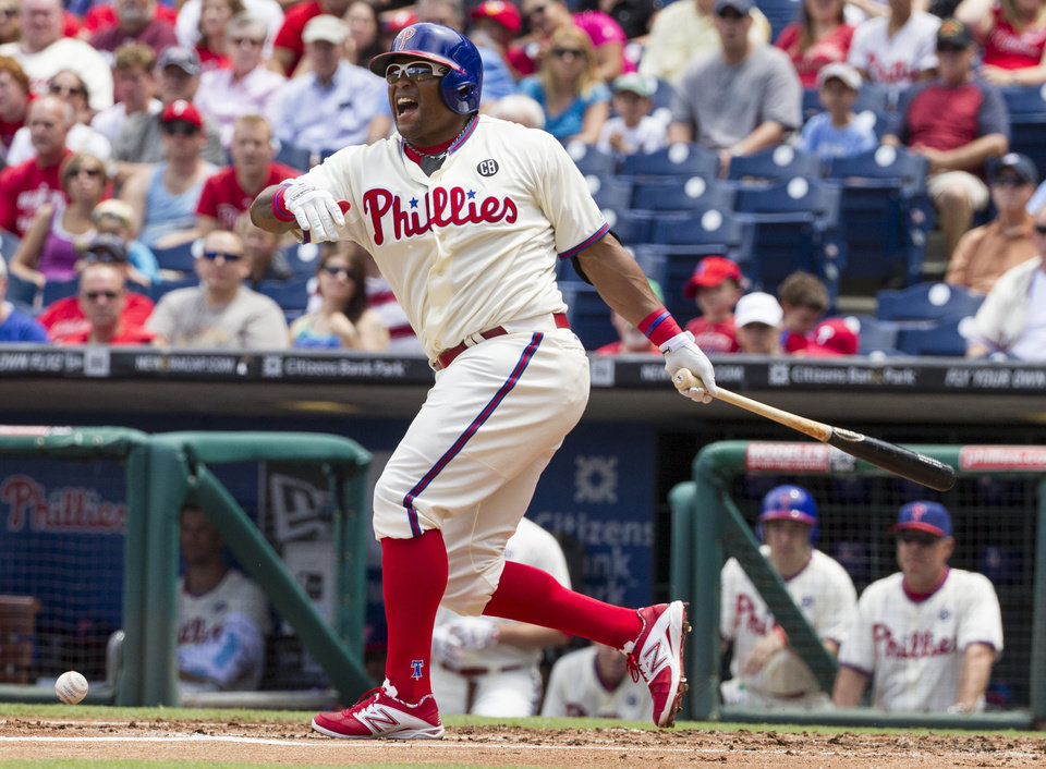 Photo - Philadelphia Phillies' Marlon Byrd fouls the ball off his foot during the first inning of a baseball game against the San Francisco Giants, Thursday, July 24, 2014, in Philadelphia. (AP Photo/Chris Szagola)