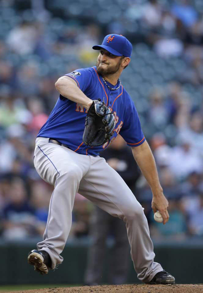Photo - New York Mets starting pitcher Jonathon Niese throws against the Seattle Mariners in the first inning of a baseball game Monday, July 21, 2014, in Seattle. (AP Photo/Elaine Thompson)