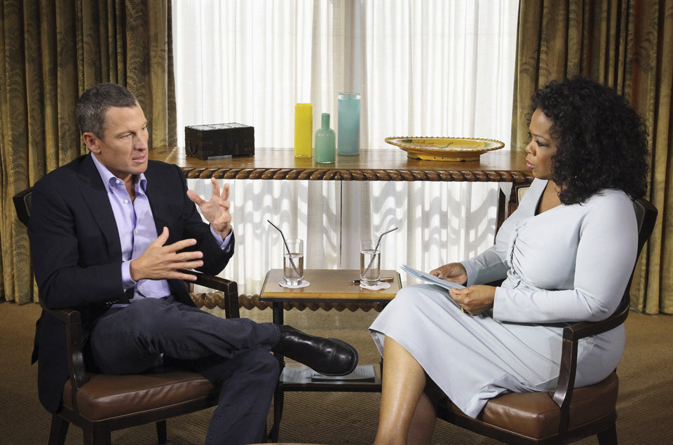 """This Monday, Jan. 14, 2013 photo provided by Harpo Studios Inc., shows talk-show host Oprah Winfrey interviewing cyclist Lance Armstrong during taping for the show """"Oprah and Lance Armstrong: The Worldwide Exclusive"""" in Austin, Texas. The two-part episode of """"Oprah's Next Chapter"""" will air nationally Thursday and Friday, Jan. 17-18, 2013. (AP Photo/Courtesy of Harpo Studios, Inc., George Burns)"""