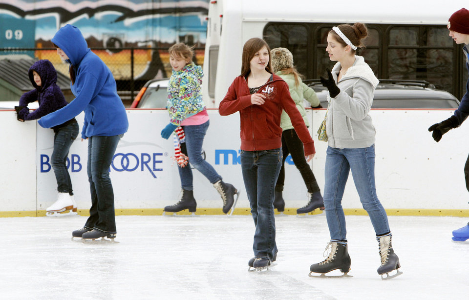 Photo - Skaters enjoy the final weekend of the Edmond Outdoor Skating Rink at the Festival Market Place in Edmond, OK, Friday, January 4, 2013,  By Paul Hellstern, The Oklahoman