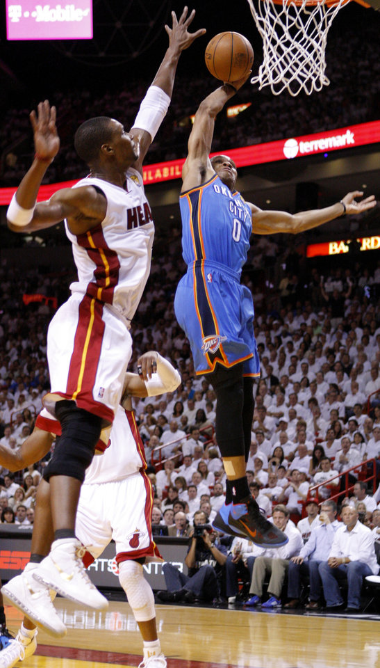Photo - Oklahoma City's Russell Westbrook (0) goes to the basket past Miami's Chris Bosh (1) during Game 4 of the NBA Finals between the Oklahoma City Thunder and the Miami Heat at American Airlines Arena, Tuesday, June 19, 2012. Photo by Bryan Terry, The Oklahoman