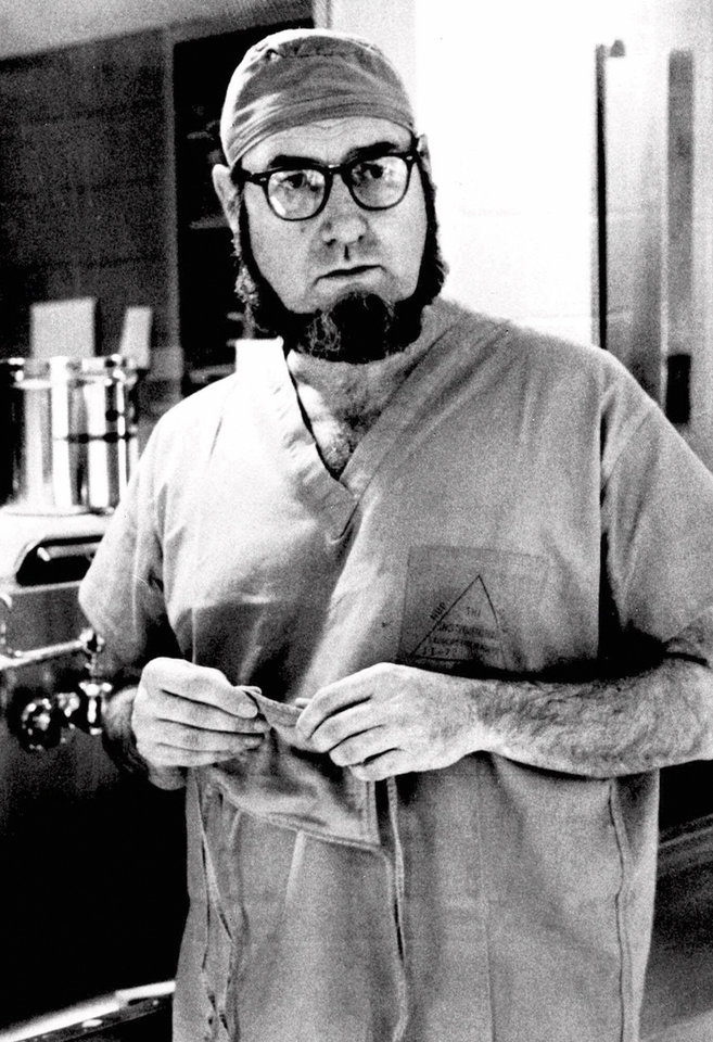 Photo - FILE - In this Sept. 19, 1974 file photo, Dr. C. Everett Koop, surgeon-in-chief at Children's Hospital in Philadelphia, talks about surgery that separated 13-month-old conjoined twins, Clara and Alta Rodriguez, at the hospital. Koop, who went on to serve as U.S. surgeon general, raised the profile of the office by riveting America's attention on the then-emerging disease known as AIDS and by railing against smoking. Koop died Monday, Feb. 25, 2013, in Hanover, N.H.  He was 96. (AP Photo/William G. Ingram, File)