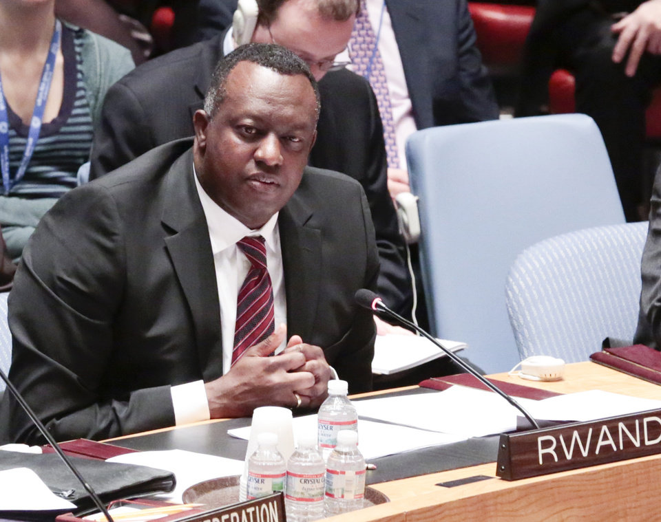 Photo - In this photo provided by the United Nations, Eugène-Richard Gasana, Permanent Representative of Rwanda to the UN, addresses the Security Council meeting at U.N. Headquarters, Wednesday, April 16, 2014, on the 1994 genocide in his country. During the session, former New Zealand ambassador Colin Keating, who was president of the Security Council in April 1994, apologized for the council's refusal to recognize that genocide was taking place in Rwanda and for doing nothing to halt the slaughter of more than one million people. (AP Photo/United Nations, Evan Schneider)