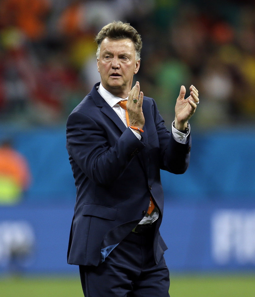 Photo - Netherlands' head coach Louis van Gaal applauds after the Netherlands defeated Costa Rica 4-3 in a penalty shootout after a 0-0 tie during the World Cup quarterfinal soccer match  at the Arena Fonte Nova in Salvador, Brazil, Saturday, July 5, 2014. (AP Photo/Natacha Pisarenko)
