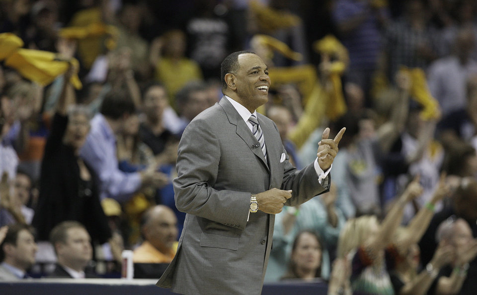 Memphis Grizzlies' Lionel Hollins smiles as the crowed celebrates the final few seconds of Game 3 in a Western Conference semifinal NBA basketball playoff series against the Oklahoma City Thunder, in Memphis, Tenn., Saturday, May 11, 2013. The Grizzlies defeated the Thunder 87-81. (AP Photo/Danny Johnston)