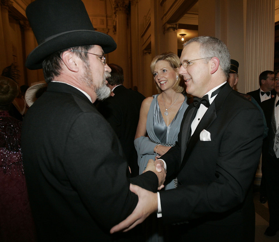 Photo - Rick Staton of Guthrie, greets Gov. Brad Henry and First Lady Kim Henry as they arrive at the Oklahoma Centennial Statehood Inaugural Ball, Saturday, Nov. 17, 2007, at the Guthrie Scottish Rite Masonic Center, in Guthrie, Okla. By Bill Waugh, The Oklahoman