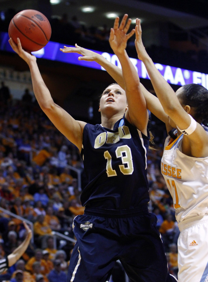 Photo - Oral Roberts forward Savanna Buck (13) shoots past Tennessee forward Cierra Burdick (11) in the first half of a first-round game in the women's NCAA college basketball tournament, Saturday, March 23, 2013, in Knoxville, Tenn. Tennessee won 83-62. (AP Photo/Wade Payne)