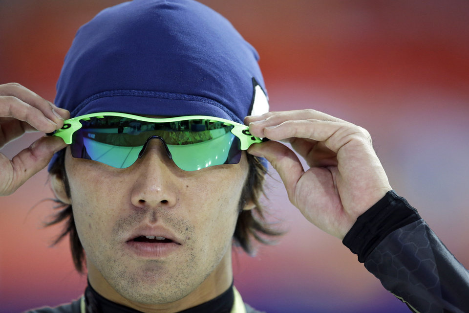 Photo - Keiichiro Nagashima of Japan adjusts his glasses as he trains at the Adler Arena Skating Center during the 2014 Winter Olympics in Sochi, Russia, Sunday, Feb. 9, 2014. (AP Photo/Patrick Semansky)