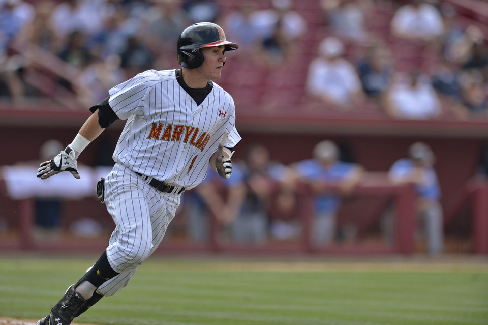 Photo - Maryland's Charlie White runs to first base after hitting an RBI single in the bottom of the ninth inning during an NCAA college baseball tournament regional game against Old Dominion in Columbia, S.C.,  Friday, May 30, 2014. Maryland won 4-3. (AP Photo/Richard Shiro)