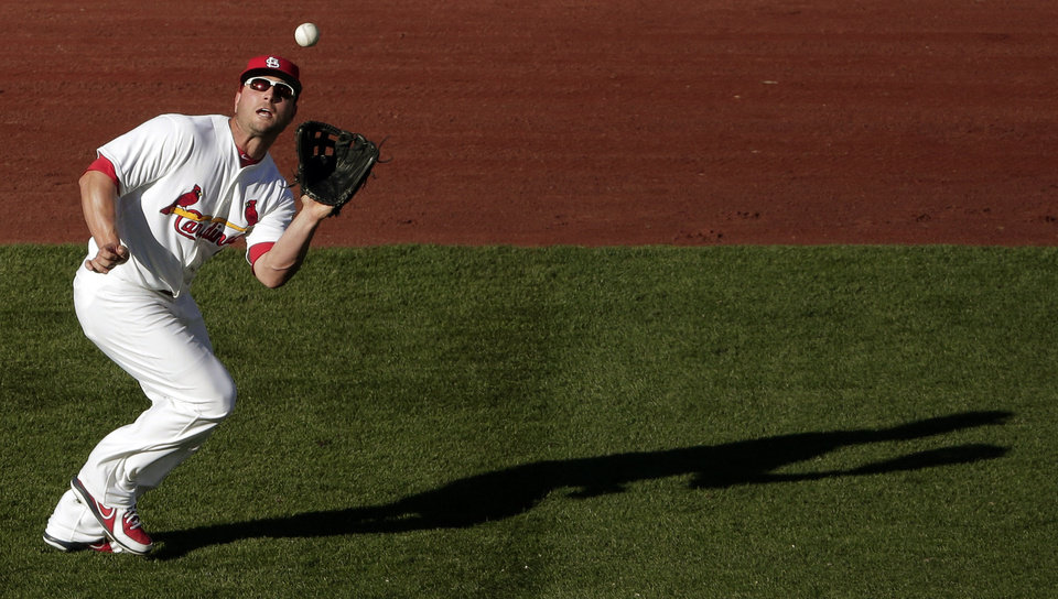 Photo -   St. Louis Cardinals left fielder Matt Holliday catches a fly ball for the out on Washington Nationals' Jayson Werth during the second inning of Game 2 of the National League division baseball series, Monday, Oct. 8, 2012, in St. Louis. (AP Photo/Charlie Riedel)