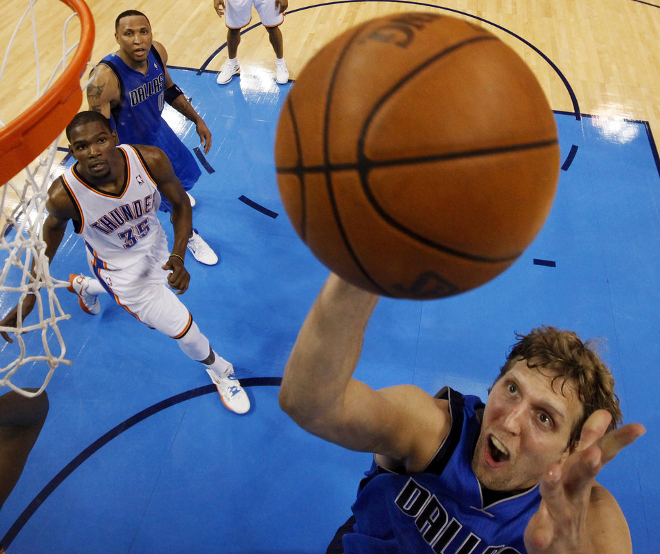 Dallas' Dirk Nowitzki (41) takes a shot in front of Shawn Marion (0) and Oklahoma City's Kevin Durant (35) during Game 2 of the first round in the NBA basketball  playoffs between the Oklahoma City Thunder and the Dallas Mavericks at Chesapeake Energy Arena in Oklahoma City, Monday, April 30, 2012.  Oklahoma City won, 102-99. Photo by Nate Billings, The Oklahoman