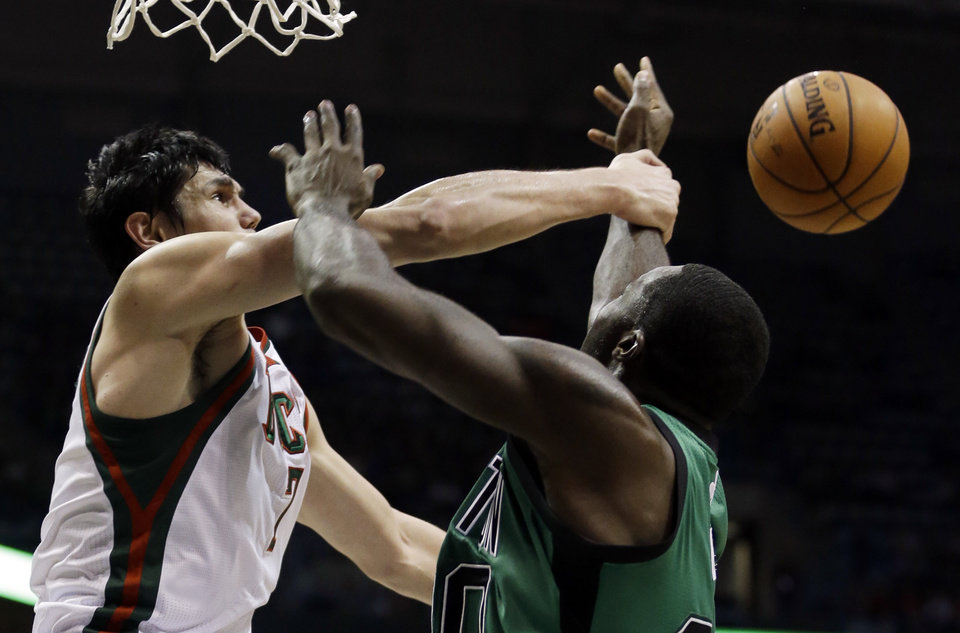 Milwaukee Bucks' Ersan Ilyasova, left, knocks the ball away from Boston Celtics' Brandon Bass during the first half of an NBA basketball game on Saturday, Dec. 1, 2012, in Milwaukee. (AP Photo/Morry Gash)