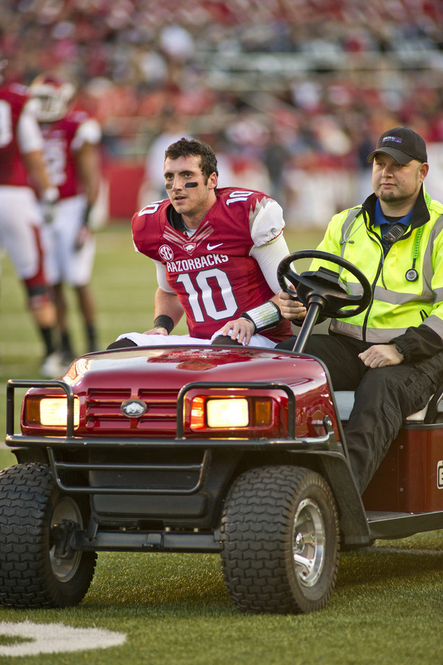 Photo - In this file photo taken Nov. 2, 2013, Arkansas quarterback Brandon Allen (10) is driven from the field following an injury during an NCAA college football game against Auburn in Fayetteville, Ark. Much of Arkansas' hopes in 2014 depend on the expected improvement of Allen, who battled injuries for much of last season. (AP Photo/Beth Hall, File)