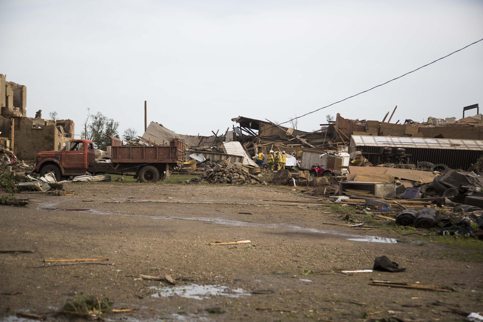 Photo - Severely damaged homes and buildings are seen after a tornado on Monday, June 16, 2014, in Pilger, Neb. The National Weather Service said at least two twisters touched down within roughly a mile of each other. (AP Photo/The Journal-Star, Stacie Scott)