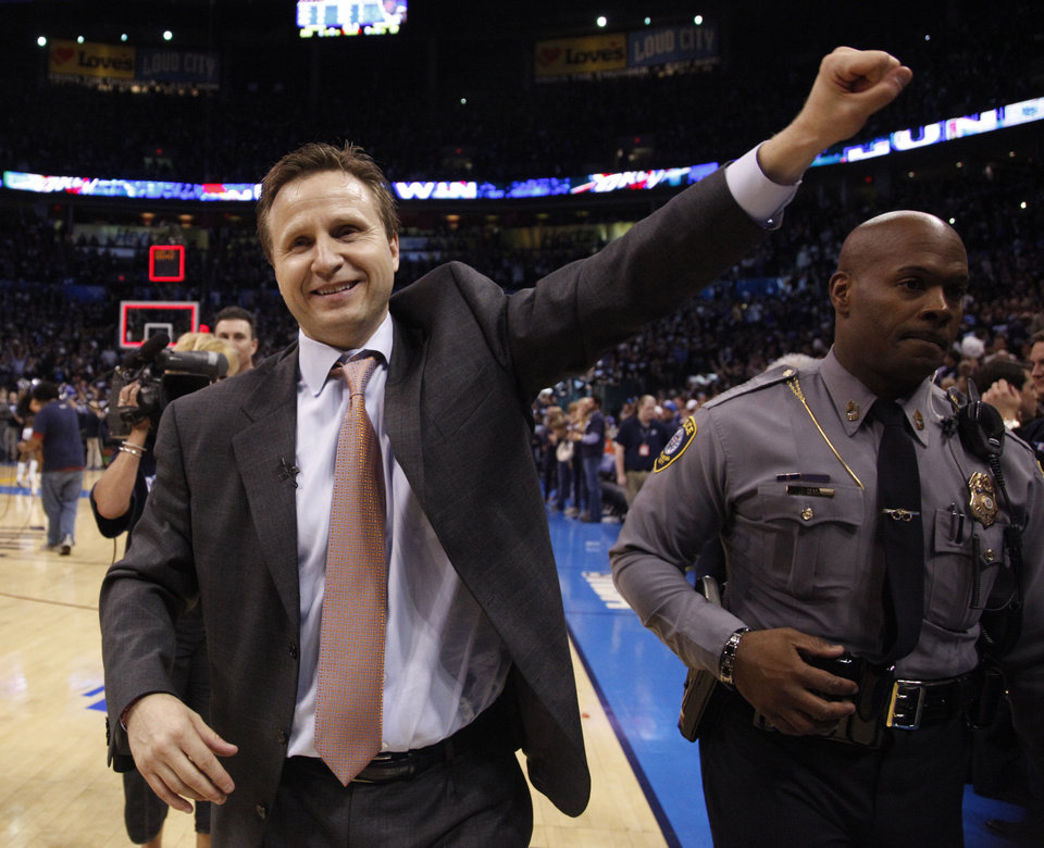 Photo - Thunder head coach Scott Brooks waves to the crowd following the NBA basketball game between the Denver Nuggets and the Oklahoma City Thunder in the first round of the NBA playoffs at the Oklahoma City Arena, Wednesday, April 27, 2011. Photo by Sarah Phipps, The Oklahoman