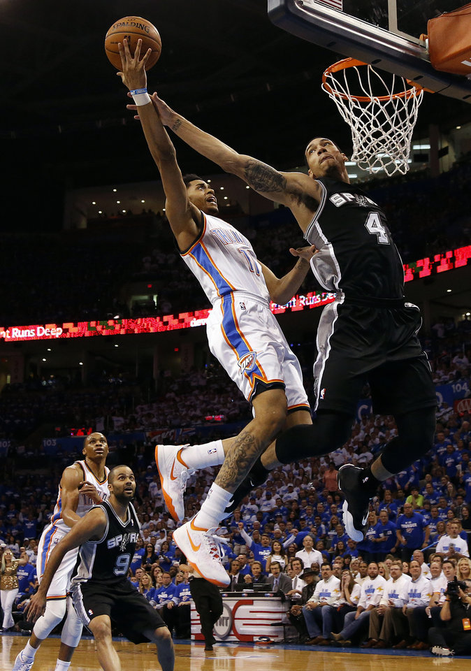 Photo - Oklahoma City's Jeremy Lamb (11) is fouled by San Antonio's Danny Green (4) as he goes up for a basket during Game 4 of the Western Conference Finals in the NBA playoffs between the Oklahoma City Thunder and the San Antonio Spurs at Chesapeake Energy Arena in Oklahoma City, Tuesday, May 27, 2014. Photo by Nate Billings, The Oklahoman