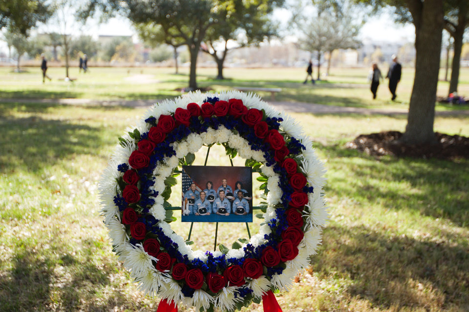 Photo - A wreath commemorating the seven astronauts who perished in the space shuttle Challenger accident rests in the Astronaut Memorial Tree Grove during the annual National Day of Remembrance ceremony at the Johnson Space Center on Jan. 27, 2011, in Houston. NASA holds the agency-wide Day of Remembrance every January to honor the fallen crews of Apollo 1 and space shuttles Challenger and Columbia.  (AP Photo/Houston Chronicle, Smiley N. Pool)
