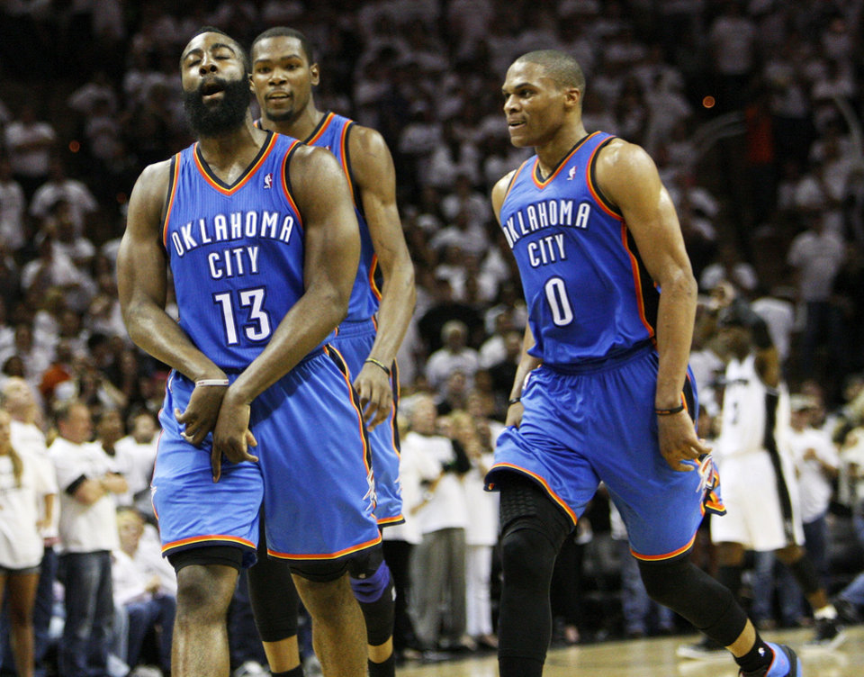 Photo - James Harden (13) reacts after making a 3-point shot late in the fourth quarter as Kevin Durant (35) and Russell Westbrook (0)  join the celebration during Game 5 of the Western Conference Finals between the Oklahoma City Thunder and the San Antonio Spurs in the NBA basketball playoffs at the AT&T Center in San Antonio, Monday, June 4, 2012. The Thunder won, 108-103. Photo by Nate Billings, The Oklahoman