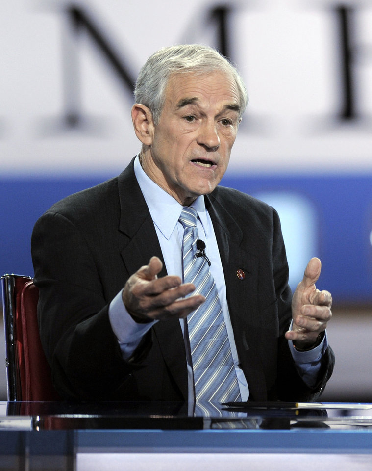 Photo - Republican presidential hopeful Rep. Ron Paul, R-Texas, answers a question during the Republican presidential debates at the Ronald Reagan Presidential Library in Simi Valley, Calif., Wednesday, Jan. 30, 2008.  (AP Photo/Mark Terrell) ORG XMIT: CAMO213