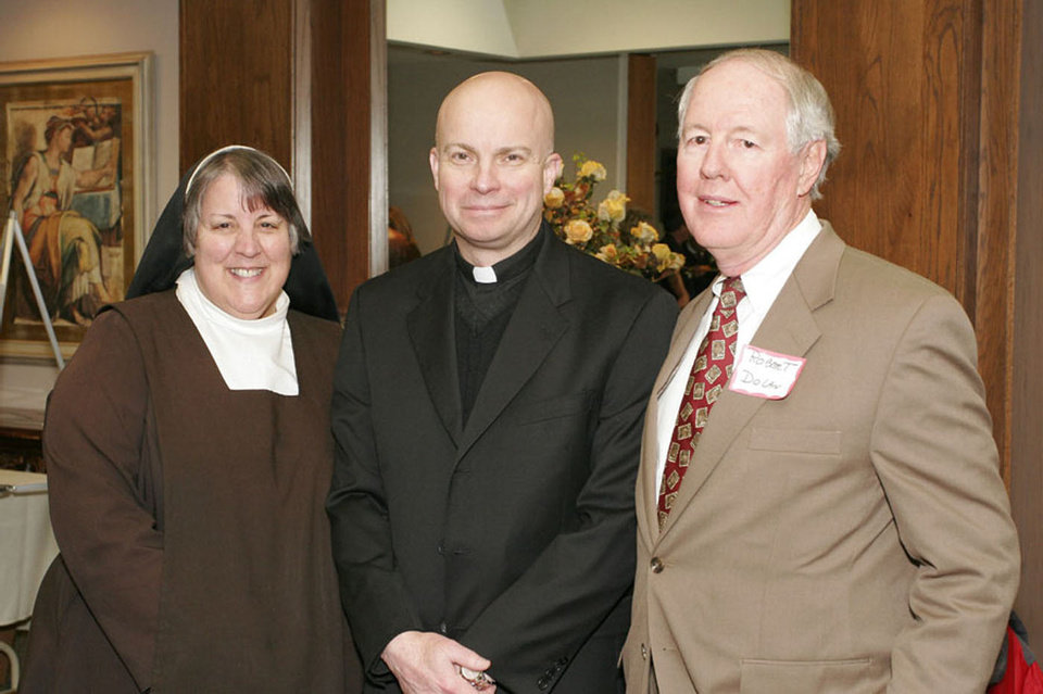 Photo - The Rev. John R. Metzinger, center, poses for a picture with Sister  Barbara Joseph Foley and Robert Dolan at a 2008 Catholic Charities event. Metzinger has been appointed to succeed Monsignor Edward Weisenburger as pastor of Our Lady's Cathedral in Oklahoma City.  David Faytinger - Freelance