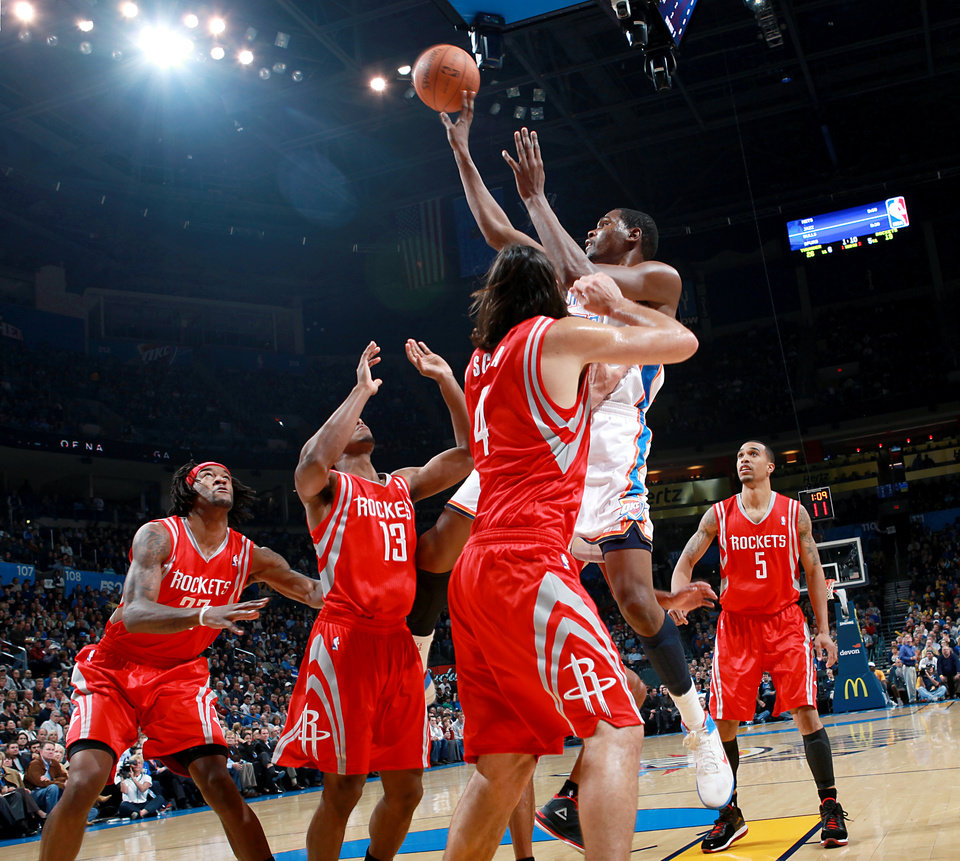 Oklahoma City\'s Kevin Durant puts up a shot in front of Houston\'s defense during their NBA basketball game at the OKC Arena in downtown Oklahoma City on Wednesday, Nov. 17, 2010. Photo by John Clanton, The Oklahoman